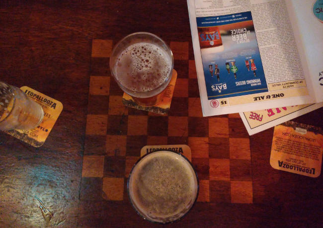 Two beers and a CAMRA mag, from above.