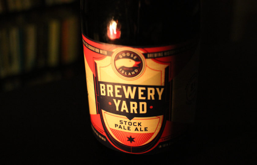 Brewery Yard beer bottle by candlelight.