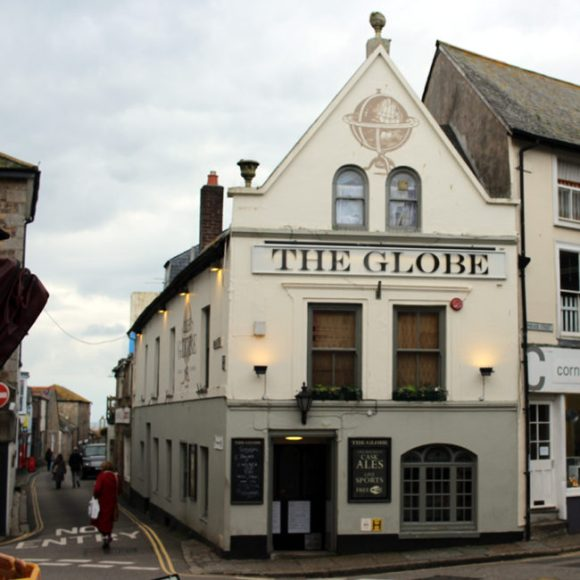 Exterior of The Globe, Penzance, on an overcast day.