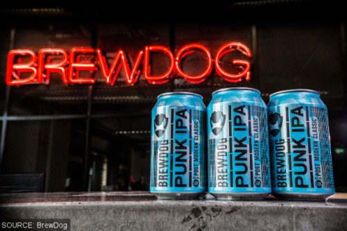 BrewDog Punk IPA in cans with neon sign.