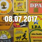 Various yellow and orange beer mats.