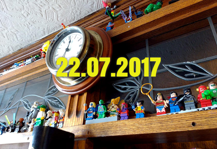 The back shelf of a pub loaded with lego minifigures.