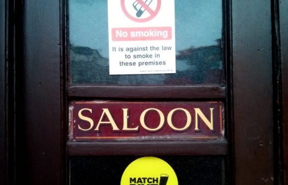 A no smoking sign on a pub door.