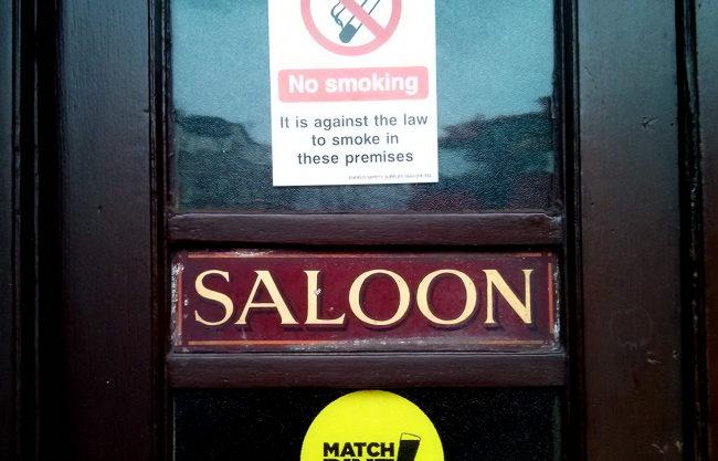 A no smoking sign on a pub door.