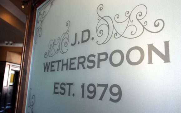 """Wetherspoon's engraved glass """"Est 1979""""."""