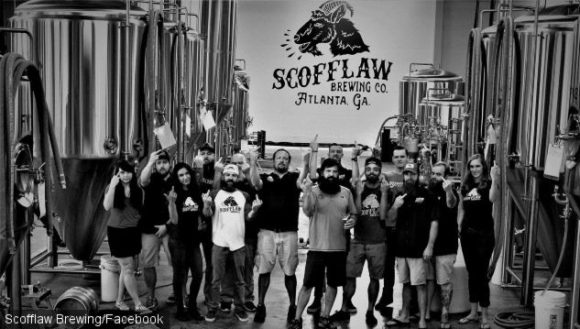 The Scofflaw Brewing team give the camera the finger.