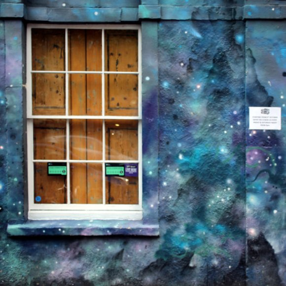 A window surrounded by painted stars.