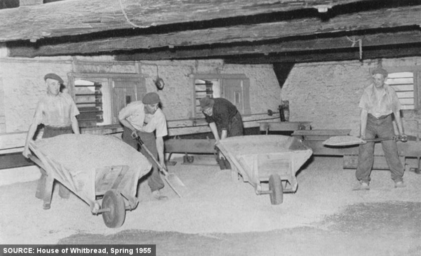 """Stripping the Kiln"" -- men with wheelbarrows."