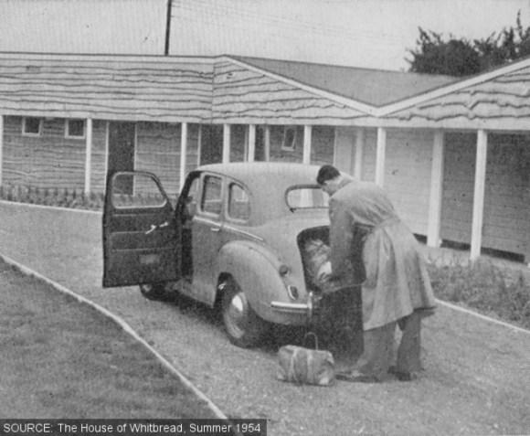 Unloading a car outside the motel.