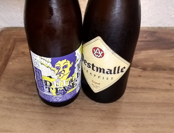 Two beer bottles side by side.