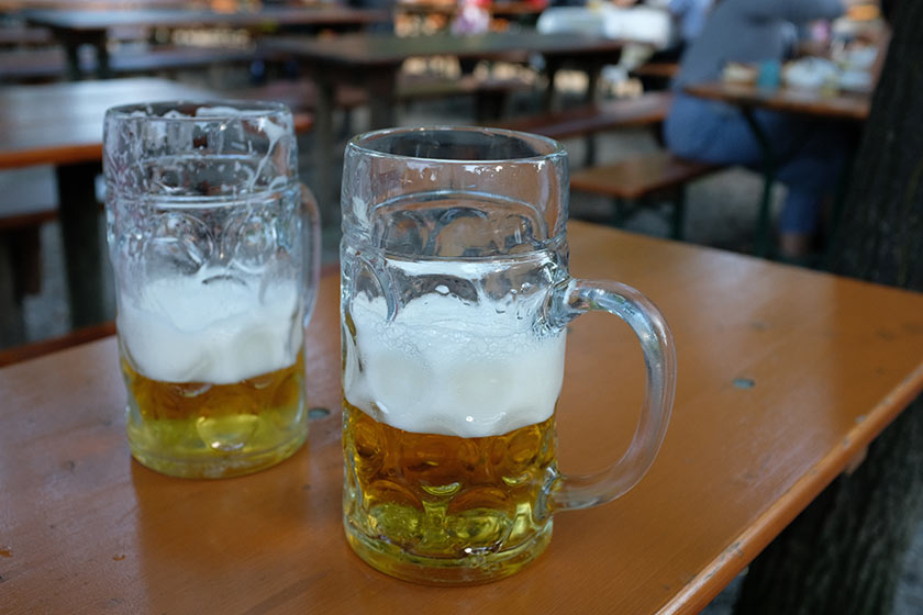 Two litre glasses of beer in a Munich beer garden.