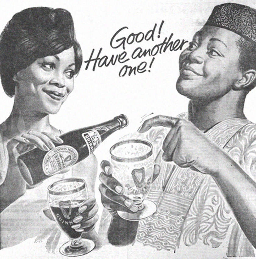 A woman pours beer into a man's glass.