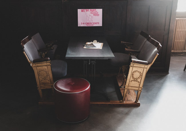 A pub table and chairs.