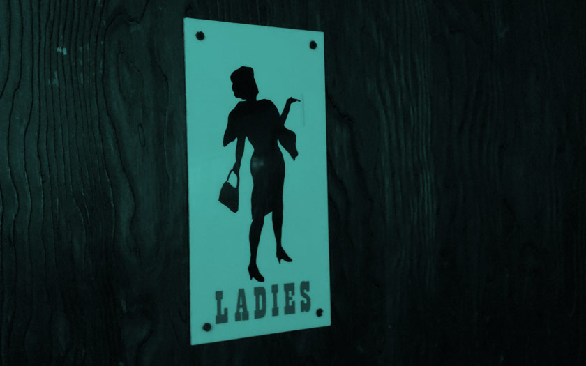 Sign for a ladies toilet.