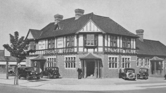 A mock Tudor pub in black-and-white.