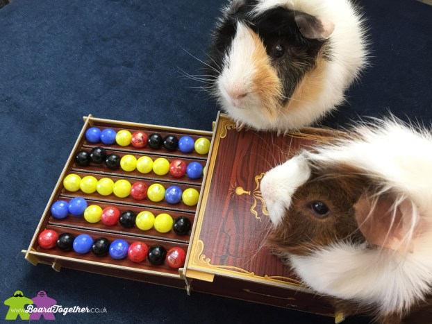 Scampi & Buddy with the boardgame Potion Explosion