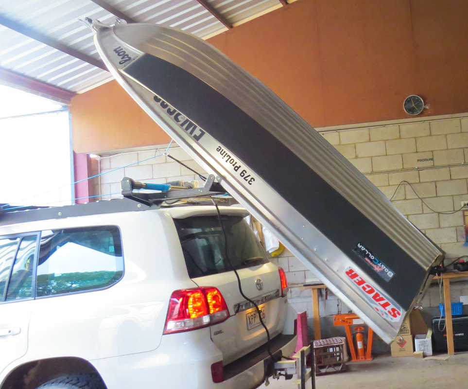 Rear-loader working smoothly to lift this Stacer Nomad onto the roof.