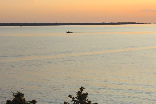 hundested seeland denmark sunset calm water boat