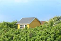 aeroeskoebing denmark hut trees sky yellow water sky blue trees