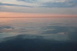 water sun up pattern pastel sky morning denmark belt belt bridge