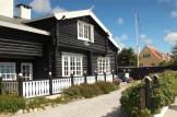 skagen denmark beach sky blue house black