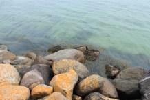 avernakø denmark water blue sky coast rocks