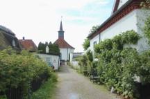 Hornbaek Denmark coast harbour church houses sky boatingthebaltic.com