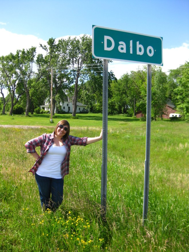 Bri leaning against the Dalbo sign.