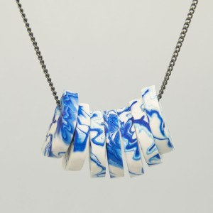 seven marbled blue and white jesmonite semi circular beads on a chain