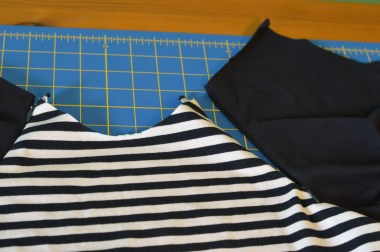 Zipper shown in on a raglan sleeve - front of shirt