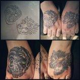 Wolf & Skull hand tattoos by Bobby Rotten
