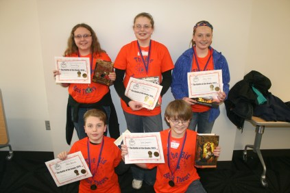 """First Place: """"The Big Book Theory"""" – Front (L to R): Aidan Burnside, Caleb Summers. Back: Carissa King, Olivia Stone, Emily Miller."""