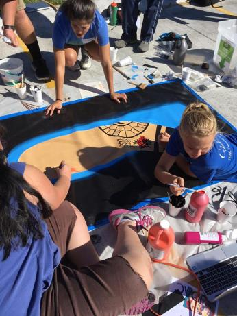 Lindsey Hafer and Becky Cox paint their tattoos