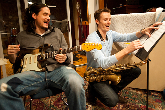 John Mayer and Bob Reynolds laughing in the recording studio
