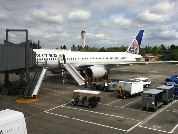 Passengers were not charged an extra slide fee when the United plane I was on experienced a 'water landing' in 2012. (The pilot actually tried to manhandle the door and triggered the float.) We did suffer a long delay, however (Bob Sullivan photo)