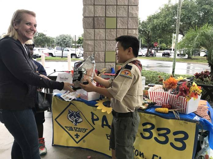 Ben Liu, from Cub Scout Pack 333 in Boca, ready to make a sale.