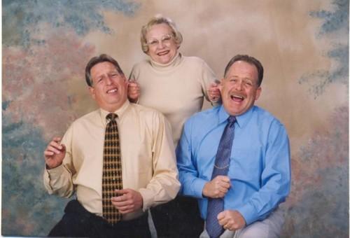 Mrs. Bodamer holding Dan and Steve by the ears.