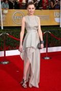 Laura Carmichael wore a Vionnet gown, carried a clutch by Lauren Merkin
