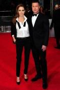 Angelina Jolie in YSL and Brad Pitt in Valentino