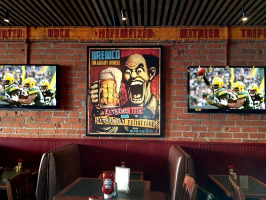 Brewco Extreme Beers poster on display at Brewco Manhattan Beach.