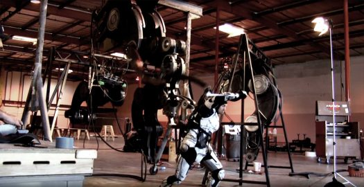 Here I am donning an early pilot suit in the PACIFIC RIM Behind The Scenes: The Conn Pod