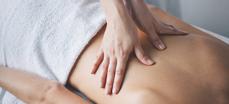 7 Deep Tissue Massage Benefits, Including Treating Chronic Back Pain