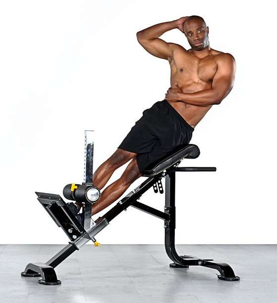 roman chair back extension muscles mustard yellow covers side bends on a hyperextension bench • bodybuilding wizard