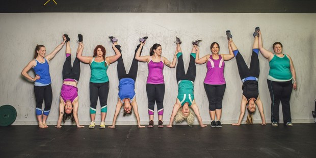 Photo from Manifesta.com showing a wide variety of body types - women in handstands and standing in a line