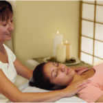 Woman laying down receiving a reiki treatment
