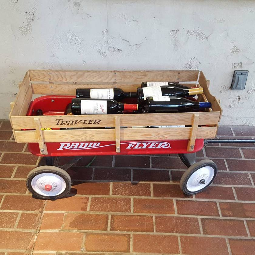 You know there's a lot of wine for cocktails tonight when it needs its own transportation. #littleredwagon