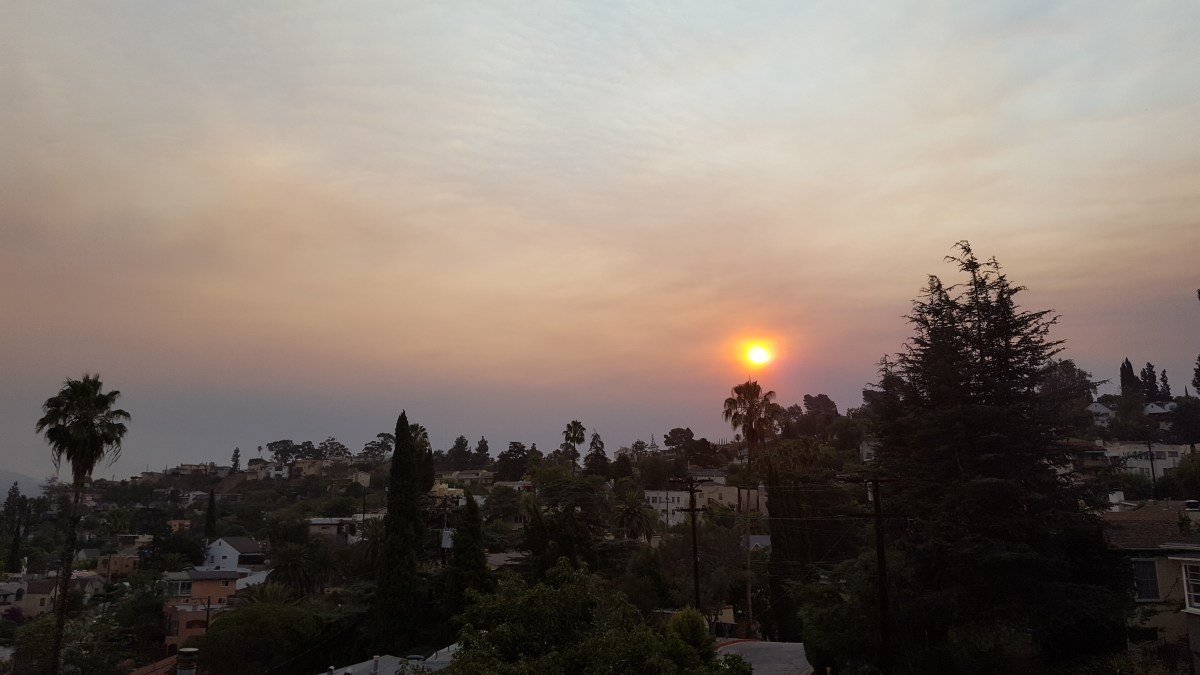 Red/Orange Sunrise resulting from Santa Clarita Sand Fire