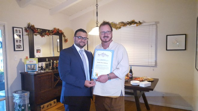 Sahag Yedalian representing Paul Krekorian's office (left) presents a certificate of appreciation from the City of Los Angeles to Executive Director Todd Bol on behalf of the Little Free Library organization.