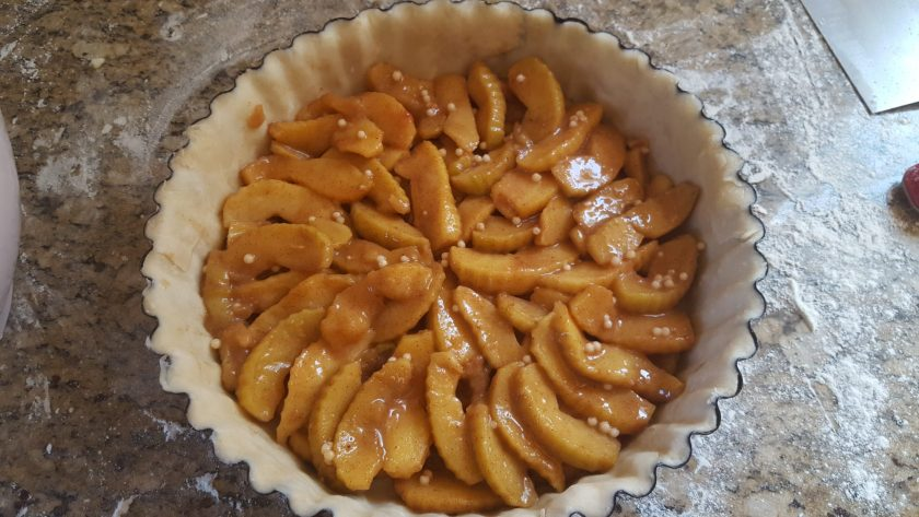 Layering your apple pie filling: radial apple slices.