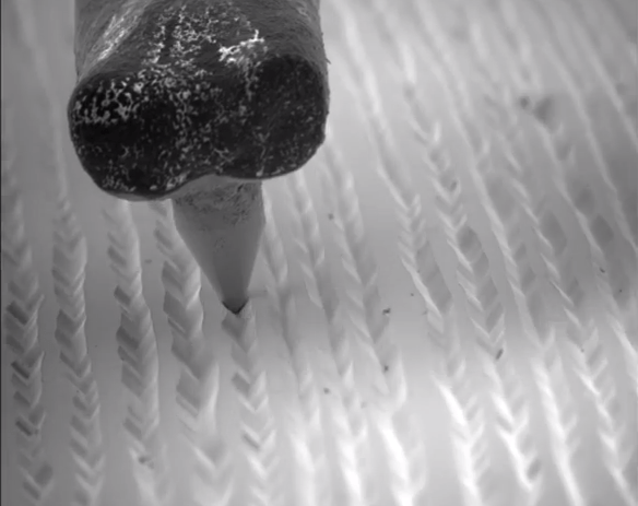 Watch a Needle Ride Through LP Record Grooves Under an Electron Microscope | Open Culture